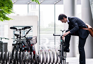 businessman parking bicycle
